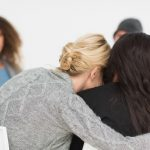 Woman hugging her friend